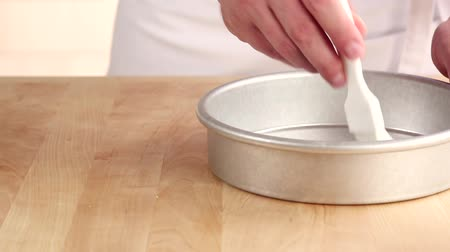 basic technique : A pie dish being brushed with soft butter