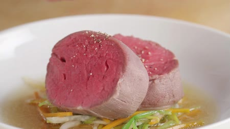 plating food : Seasoning poached fillet steak