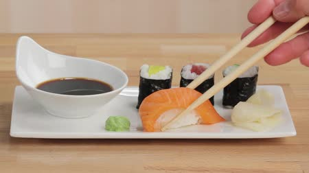 specialties : Picking up nigiri sushi with chopsticks