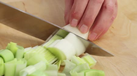 being cut up : Cutting up leeks Stock Footage