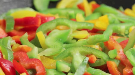 levantado : Colourful pepper strips being fried