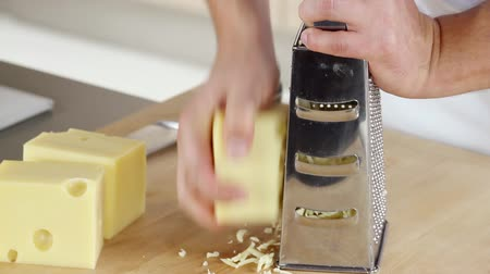 pieces of cheese : Coarsely grating cheese Stock Footage