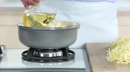 poured out : White wine being added to a fondue pot