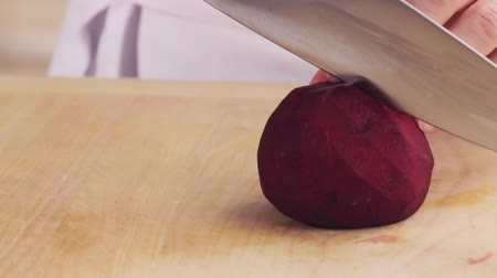 halve : A beetroot being halved Stock Footage