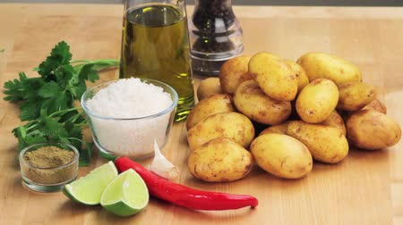 seasalt : Ingredients for potatoes with a salt crust and a herb sauce Stock Footage