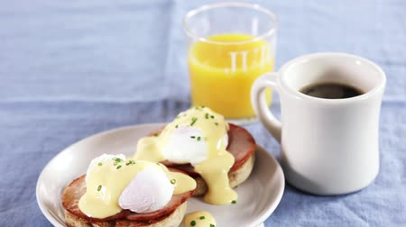 specialties : Eggs Benedict (an English muffin with ham, poached egg and Hollandaise sauce, USA) Stock Footage