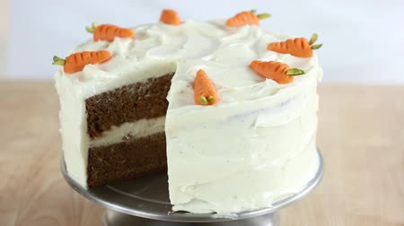specialties : A sliced carrot cake with cream cheese frosting (USA)