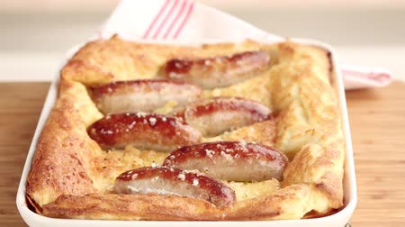 specialties : Toad in the hole (sausages in batter, England) Stock Footage