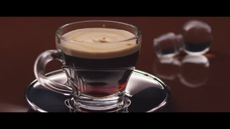 specialties : Drops falling into a cup of espresso