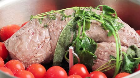 veal recipe : The fillet of veal and tomatoes being seasoned and covered Stock Footage