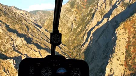 shadows : Aerial shot from chopper cockpit of rocky mountains in Utah. Stock Footage