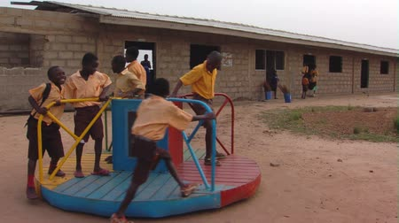 batoh : Wide shot of kids playing at school