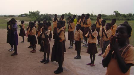cantora : Wide shot of kids lined up for school