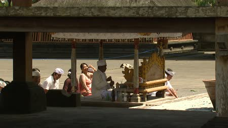 padre : Wide shot of people at temple ceremony Stock Footage