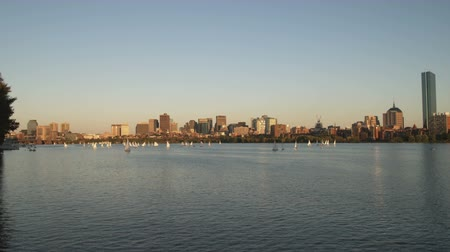 river ocean : Far shot of Boston from across the Charles river at sunset Stock Footage