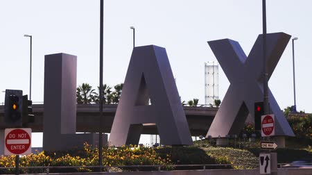uluslararası : Wide shot of LAX sign outside of airport Stok Video