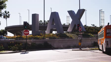 airport bus : Far shot of LAX sign outside of airport Stock Footage