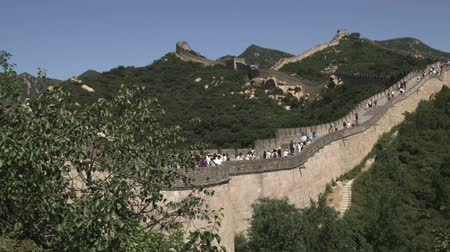 great wall of china : A panning wide shot of the Great Wall of China in the Badaling section.