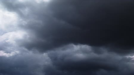 mroczne : Timelapse of dark clouds rolling across the sky with glimpses of white and sunshine. Wideo