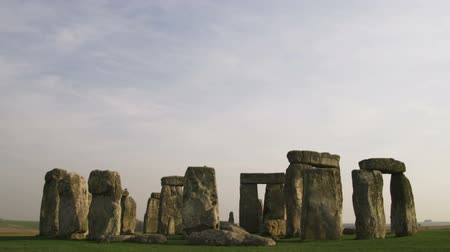 earthworks : Wide shot tilt down to Stonehenge Stock Footage