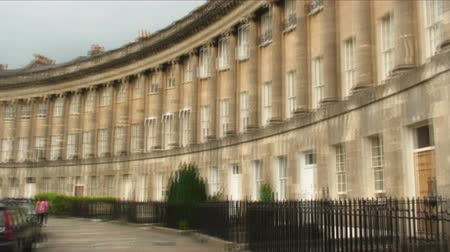 row : Panning shot showing the Royal Crescent homes in Bath, England.