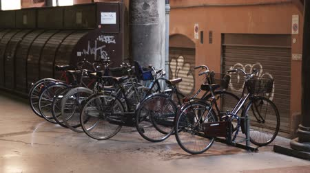 bologna : Wide shot of old bikes parked at rack inside mall Stock Footage