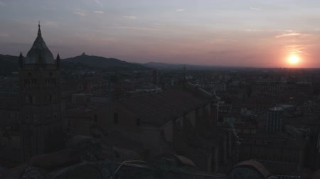 bolognai : Wide shot of ancient city silhouette with sunset