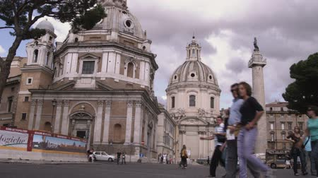 pro government : A wide shot of tourists walking around Rome Italy.