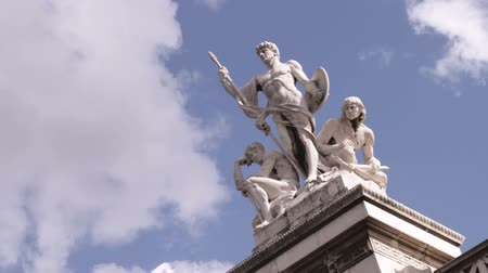 pro government : A shot of statues in front of the Patriae Vnitati, a government building in Rome Italy. Stock Footage