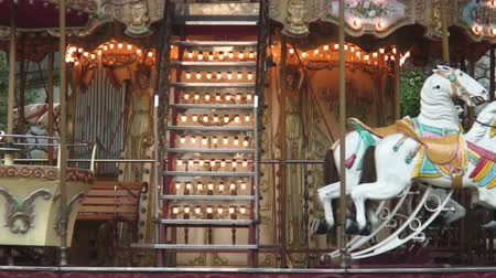 koń : Shot of a merry-go-round revolving in Paris