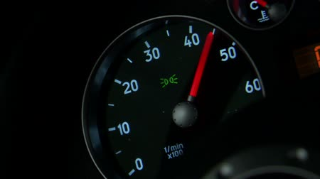rpm : A close up of an RPM gauge. The dial goes up and down as the car engine is revved.