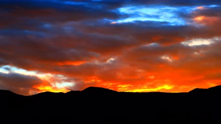 shadows : Time-lapse shot of sky turning from dusk to night over Utah. The sky turns from orange to black. Stock Footage