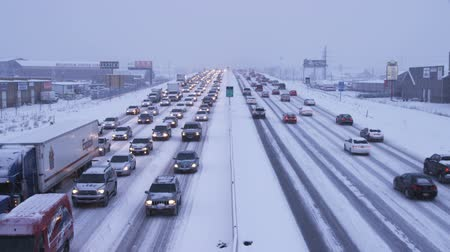 deli : Wide shot of traffic in winter storm