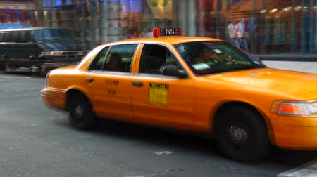 nyc : Tilt and pan down from the M and Ms World to a taxi cab near Times Square in New York City.