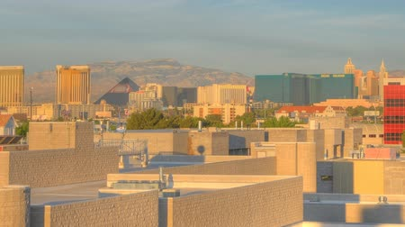 tesisler : Timelapse, panning of the University of Nevads during a sunrise with views of buildings, skyline and mountains far away.