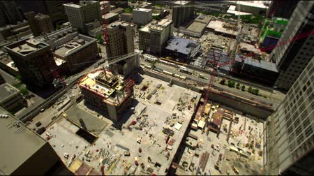 construction chantier : Jib pan du toit d'un immeuble d'un chantier de construction au centre-ville de Salt Lake City, UT Vidéos Libres De Droits
