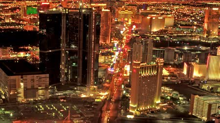 panorâmico : Static shot from the top of the Stratosphere Hotel in Las Vegas at dusk across the Strip to hotels and traffic far below.