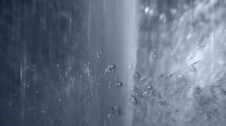 sütun : Close-up of a powerful, vertical gushing water fountain with water droplets splashing all about.