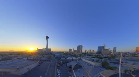 tű : sped-up video of the stratosphere tower in las vegas from early morning to early afternoon.