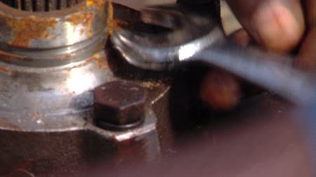 csavarkulcs : Close up of persons hands fixing machine with wrench Stock mozgókép