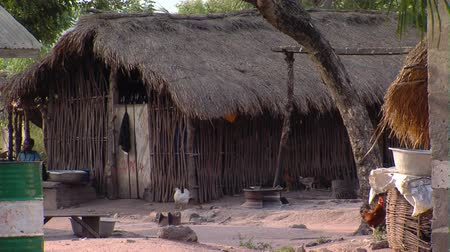 chata : Wide shot of grass hut and yard