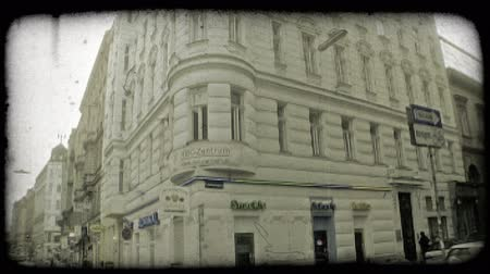 mindennapi : Corner of Austrian street lined with tall buildings and shops. Vintage stylized video clip.