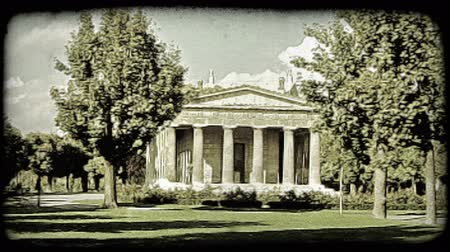 europa : A shot of a garden in Vienna and an ancient structure. Vintage stylized video clip.