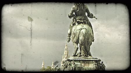 war : Shot of a statue showing a man riding a horse in Vienna. Vintage stylized video clip.
