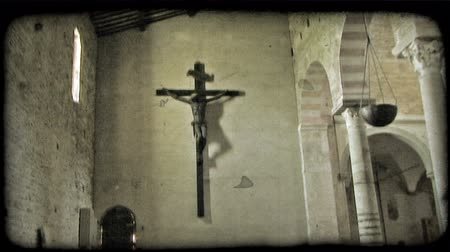 sütun : Shot of a statue of the Crucifix hanging on the wall of an Italian cathedral. Vintage stylized video clip.