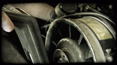 undo : Electronic reader is used to measure specifications on a cars upbcaps and tire parts. Vintage stylized video clip. Stock Footage