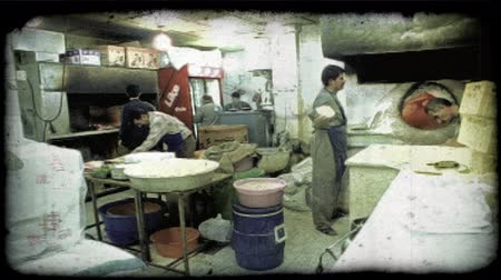 konyhai : Kuwaitee men in restaurant kitchen cooking. Vintage stylized video clip.