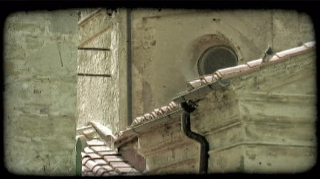 csővezeték : Shot of the roofs of several buildings in Italy. Vintage stylized video clip.