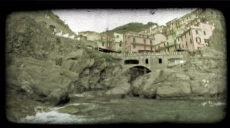 objektiv : A wide angle lens shot that pans from an Italian beach town to a marina. Vintage stylized video clip.