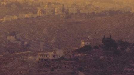 filistin : Time-lapse of Bethlehem at sunset. From the south east hillside. Panning shot.